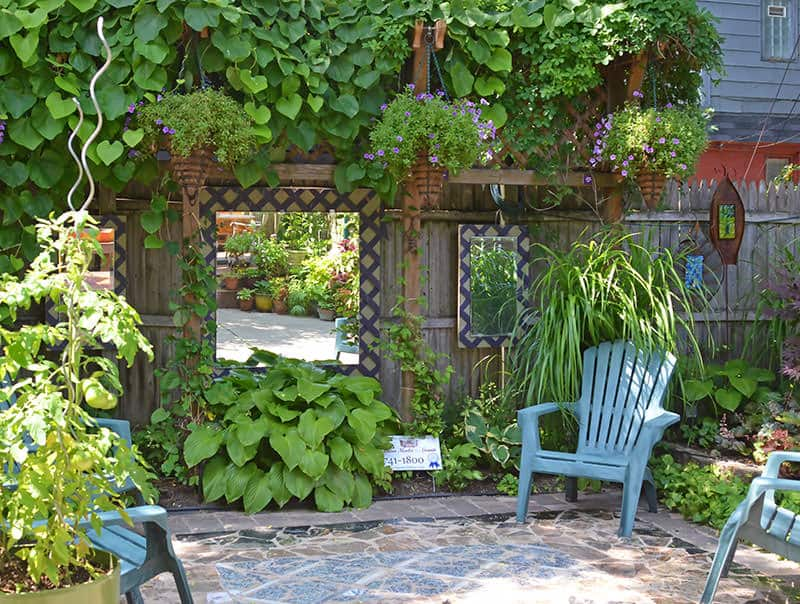 Hang mirrors to give the illusion of more garden space