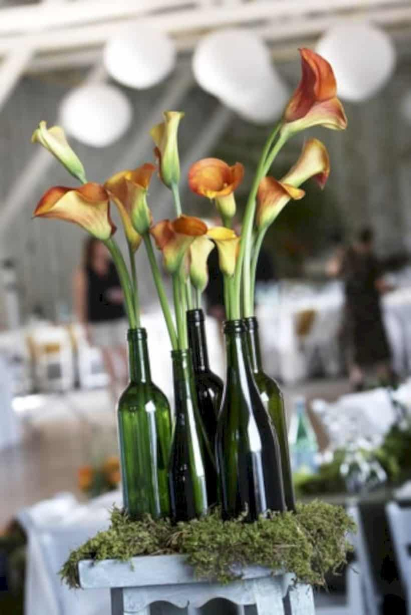 Simple but beautiful cleaned bottle wedding centrepiece