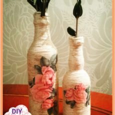 Yarn and decoupage wine bottle decor