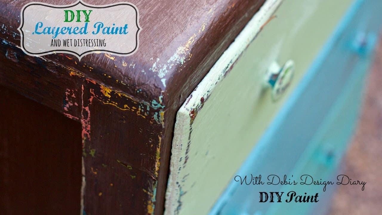 Brown and blue layered paint wet distressed dresser