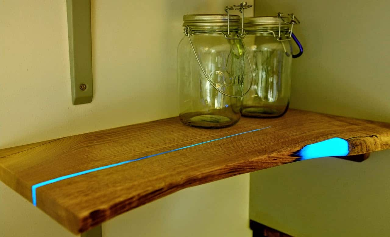 Brown wood and blue glowing inlaid resin shelves