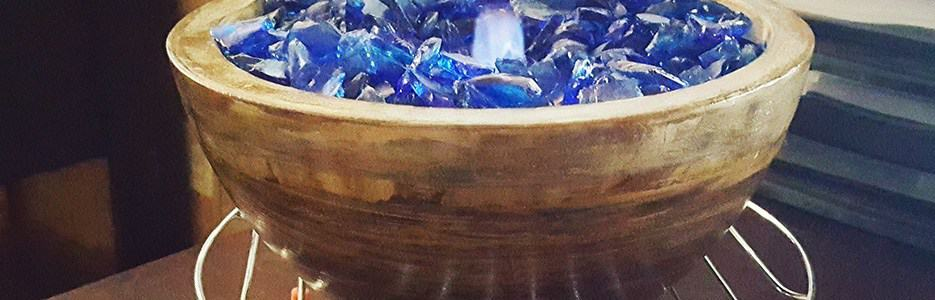 Diy brown concrete fire bowl with blue chopped fibreglass