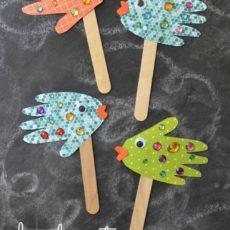 Handprint fish puppets
