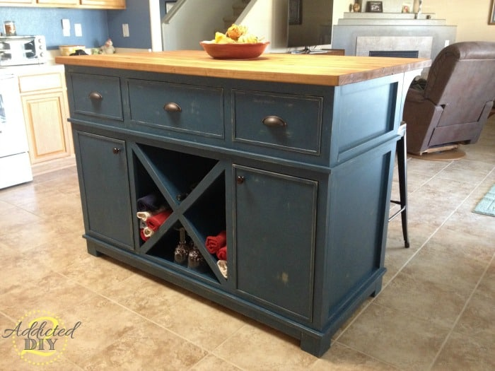 Kitchen island with x shelf and seating