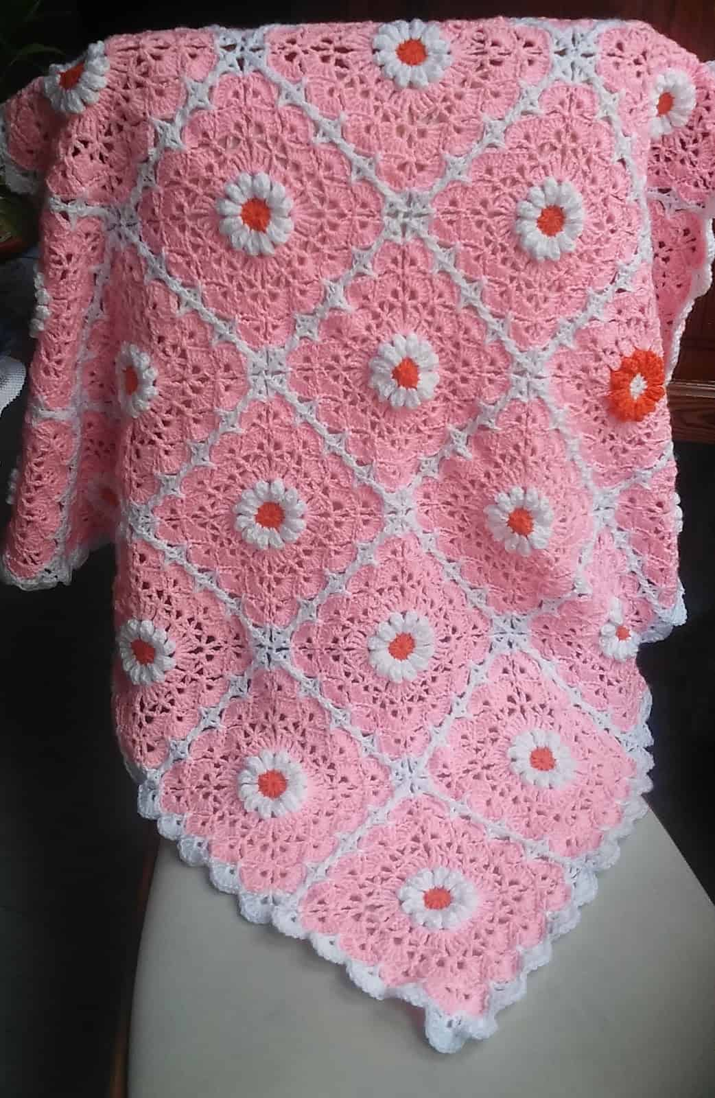 Pink daisy crocheted blanket