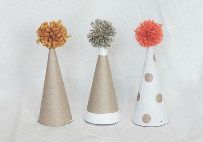 Pom pom topped diy birthday hats