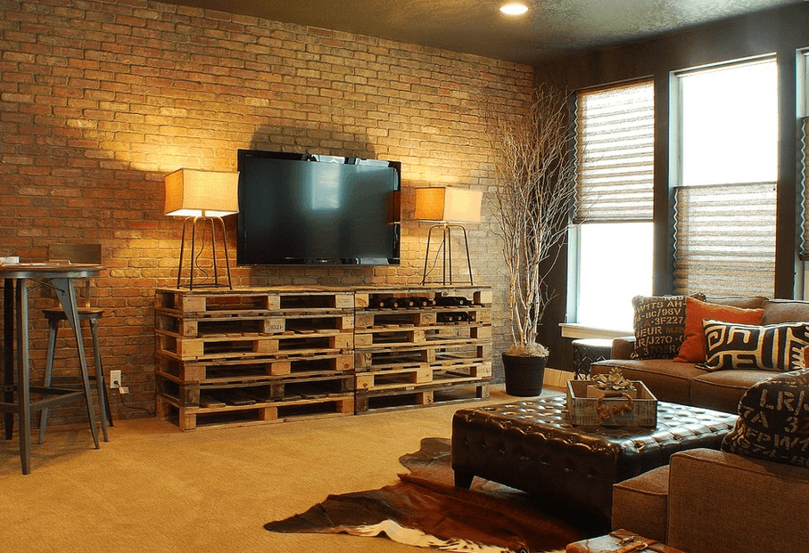 Stacked pallet durniture with brick and metal for rustic industrial chic