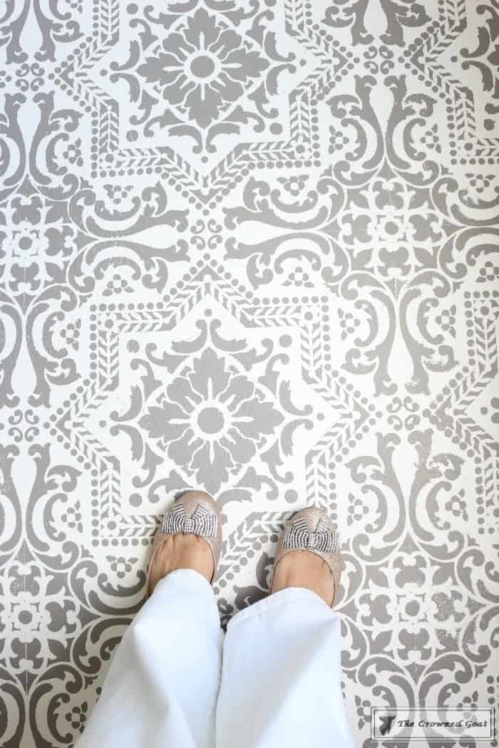 Stencilled concrete living room floor