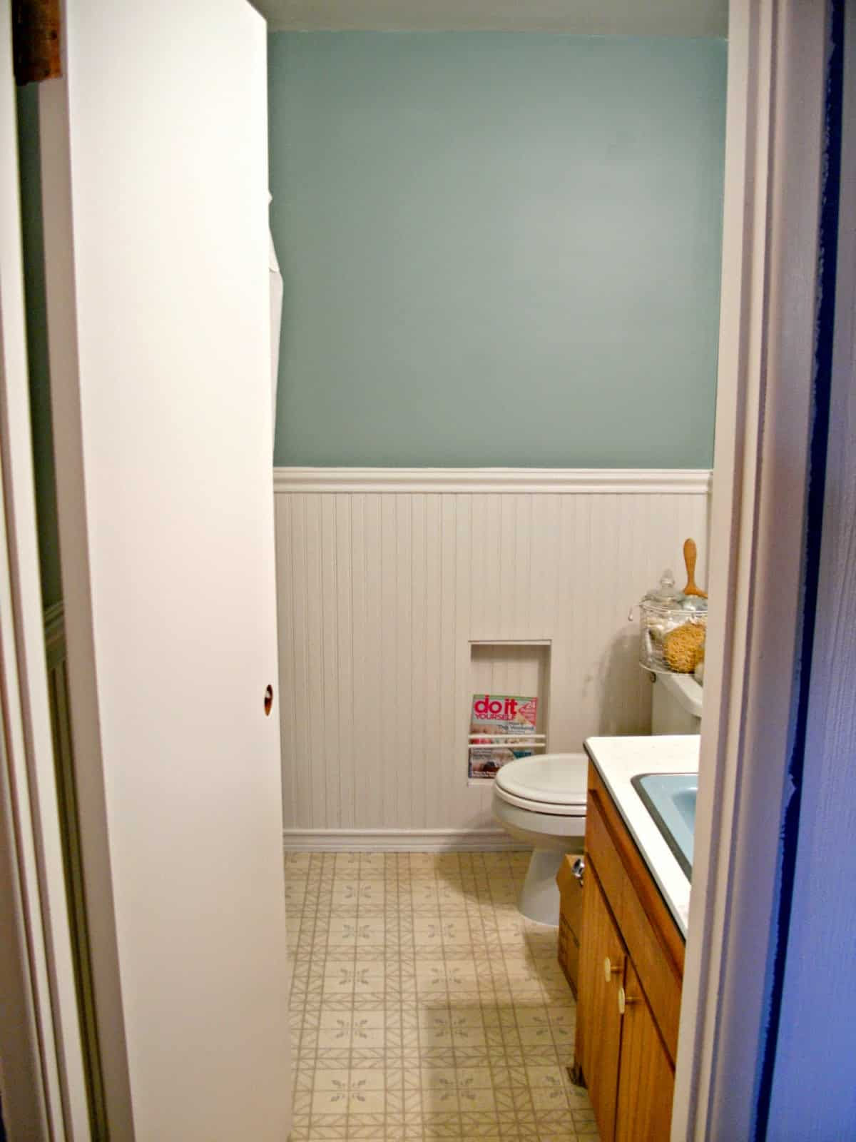 Wainscoting with a built in magazine rack