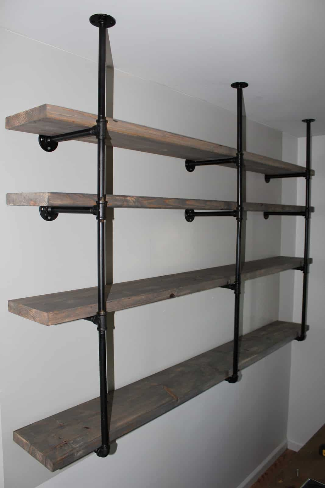 Wall and ceiling braced industrial shelves
