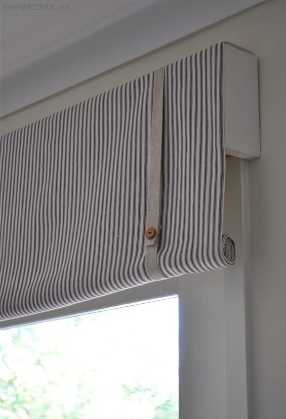 Belted and rolled window valance