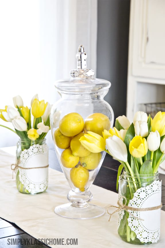 Bright lemons in a glass vase
