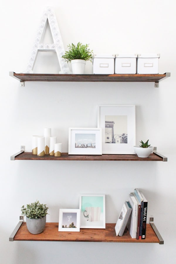Distressed wood and metal bracket floating shelves