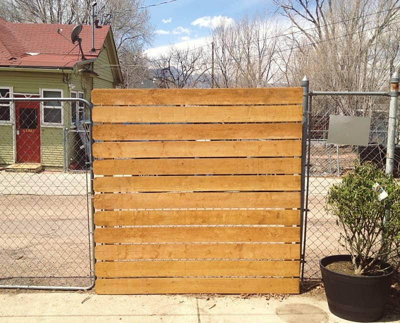 Dressed up reclaimed wood chain link fence