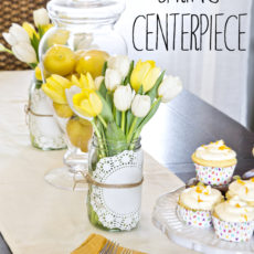 Glass jar, daffodil, and paper doily centrepiece