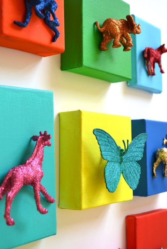 Painted and glittered animal canvases