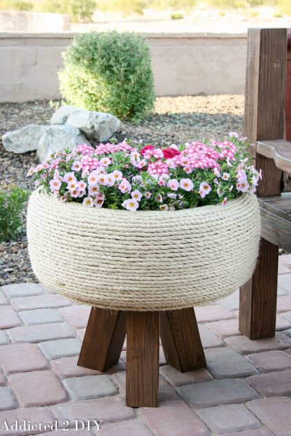 Rope wrapped old tire patio planter