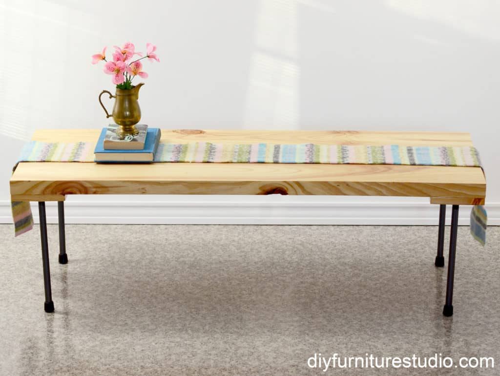 Rustic modern coffee table with plumbing pipe legs