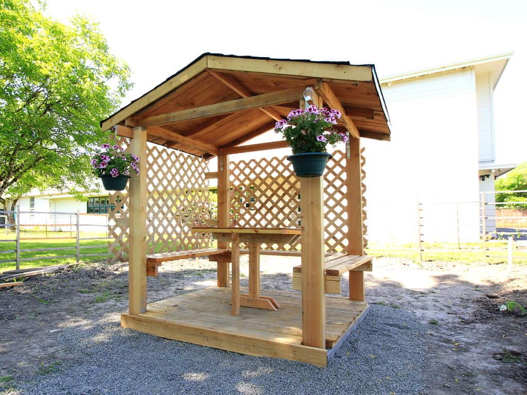 Simple backyard gazebo with floating benches