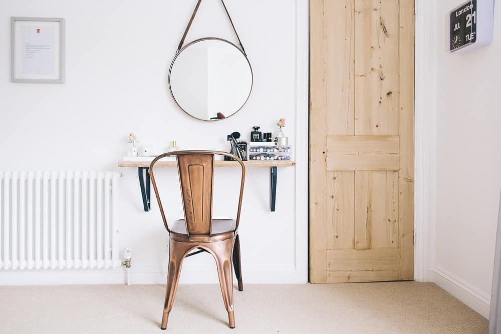 Space efficient vanity from a floating shelf and a hanging mirror