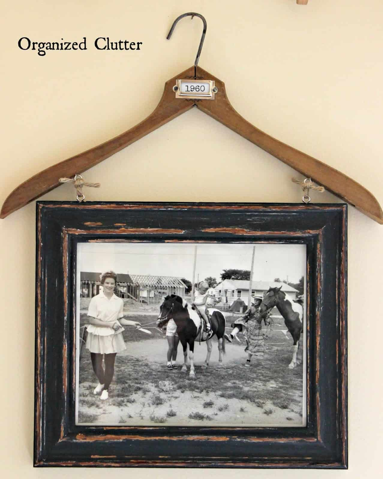 Coat hanger photo display