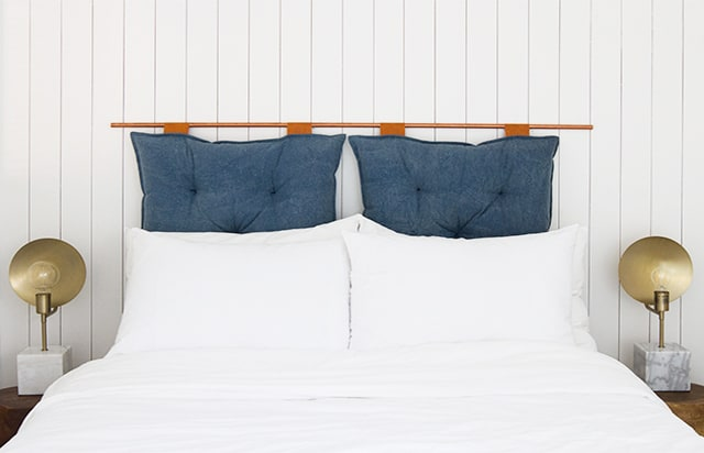 Copper pipe and hanging cushion headboard
