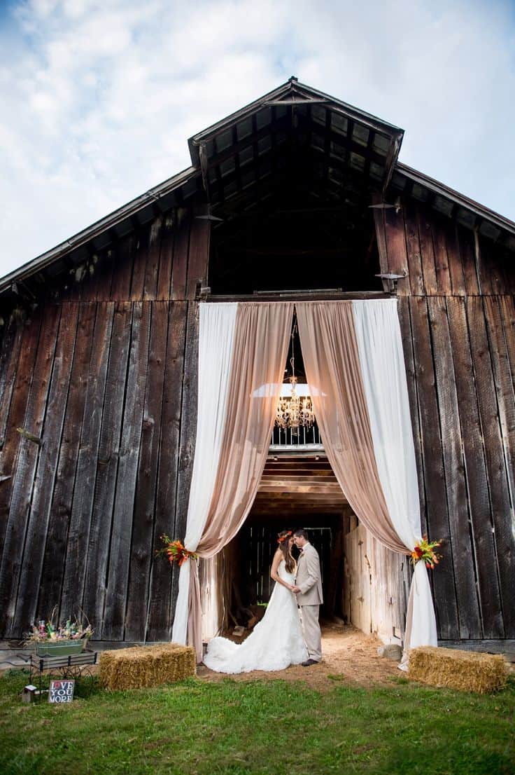 Curtains hung from a barn doorway
