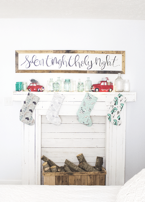Diy rustic wood faux fireplace with a mantel