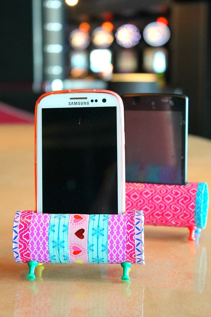 Make a phone holder from a toilet paper roll and tacks