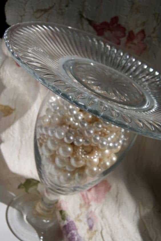 Pearl, wine glass, and plate stand