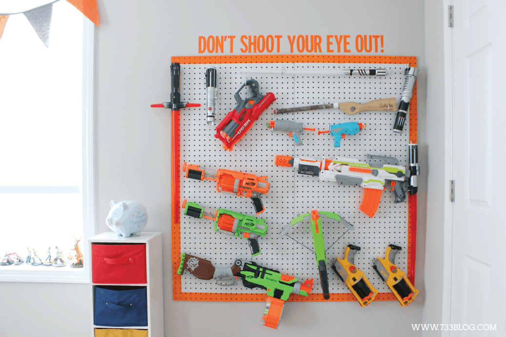 Pegboard toy weapons storage
