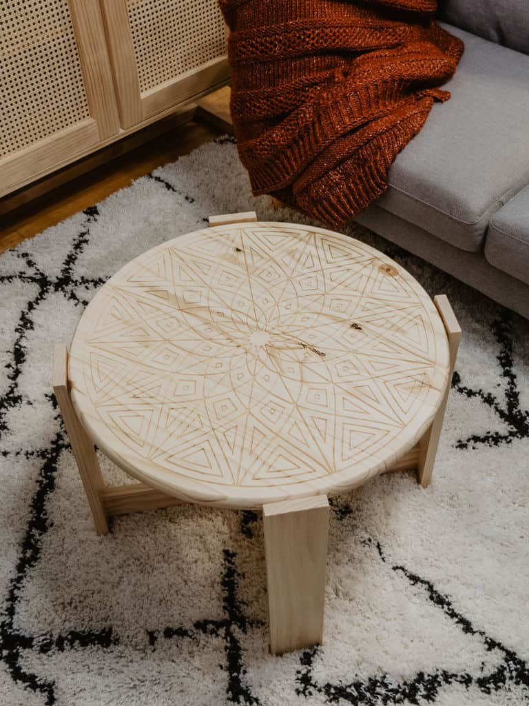 Rounded x carve design top coffee table