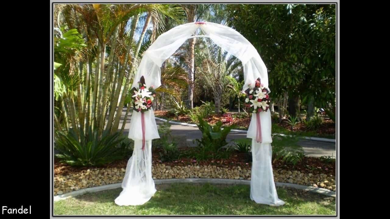 Rounded curtain and double bouquet wedding arch