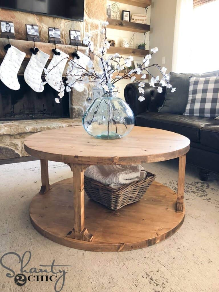 Rounded wooden coffee table with a rounded base