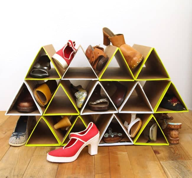 Space saving cardboard triangle show rack