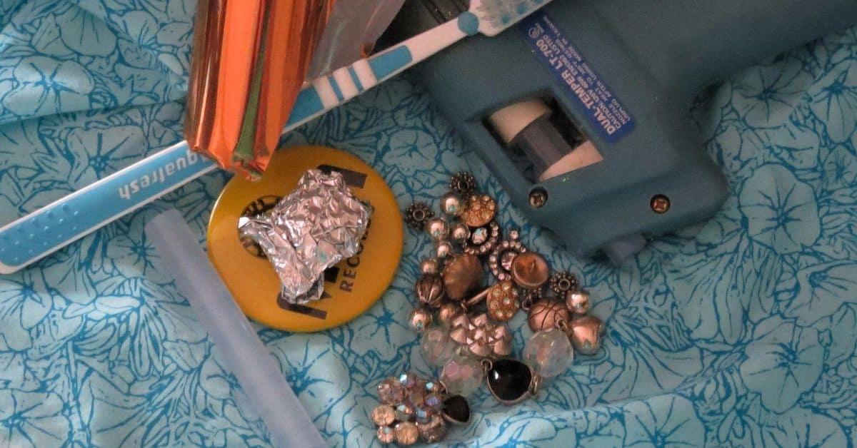 Toothbrush and broken jewelry brooch