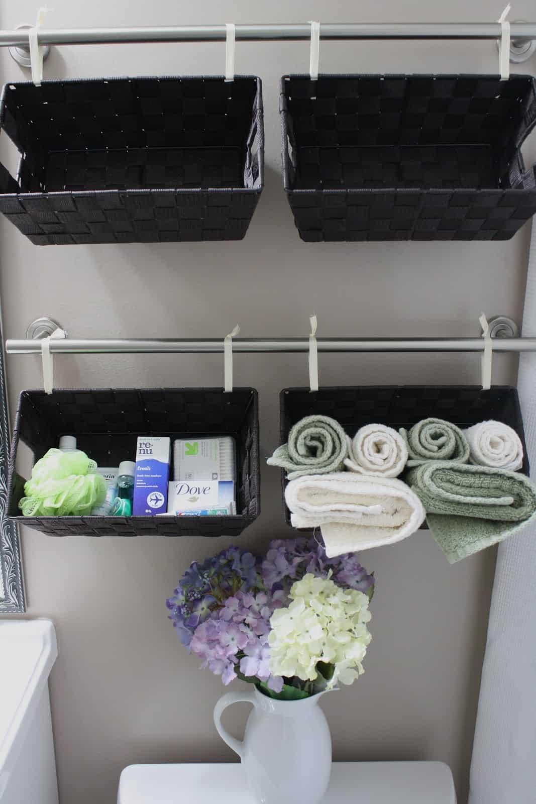 Towel rod and hanging basket bathroom wall