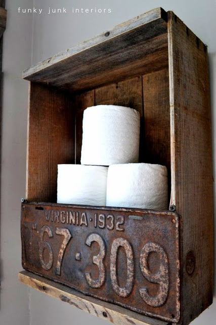 Wall mounted toilet paper crate