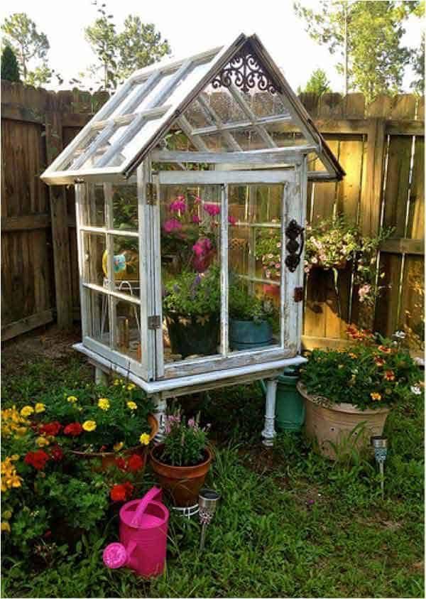 Miniature flower greenhouse from old windows