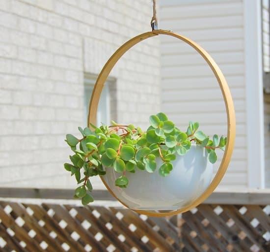 Balanced embroidery hoop hanging planter