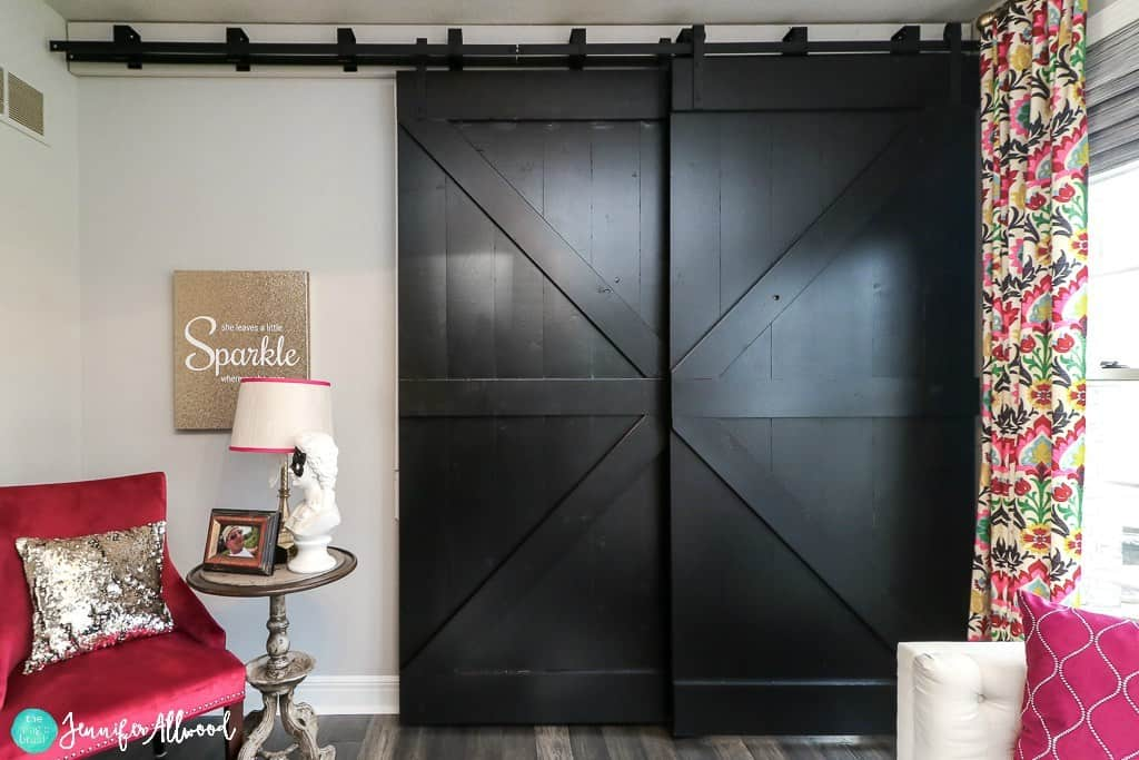 Black barn doors for a formal home office space