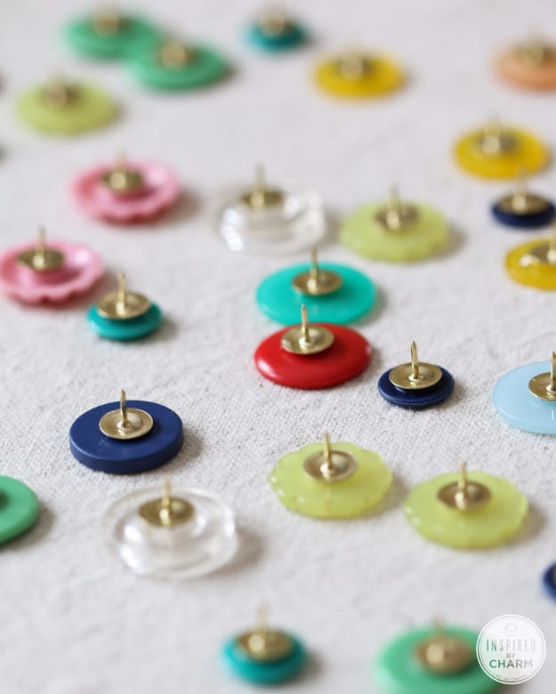 Button thumb tacks