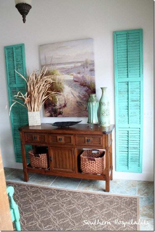 Colourful repurposed shutter wall decor