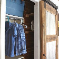 Corrugated metal and wood barn door for the closet