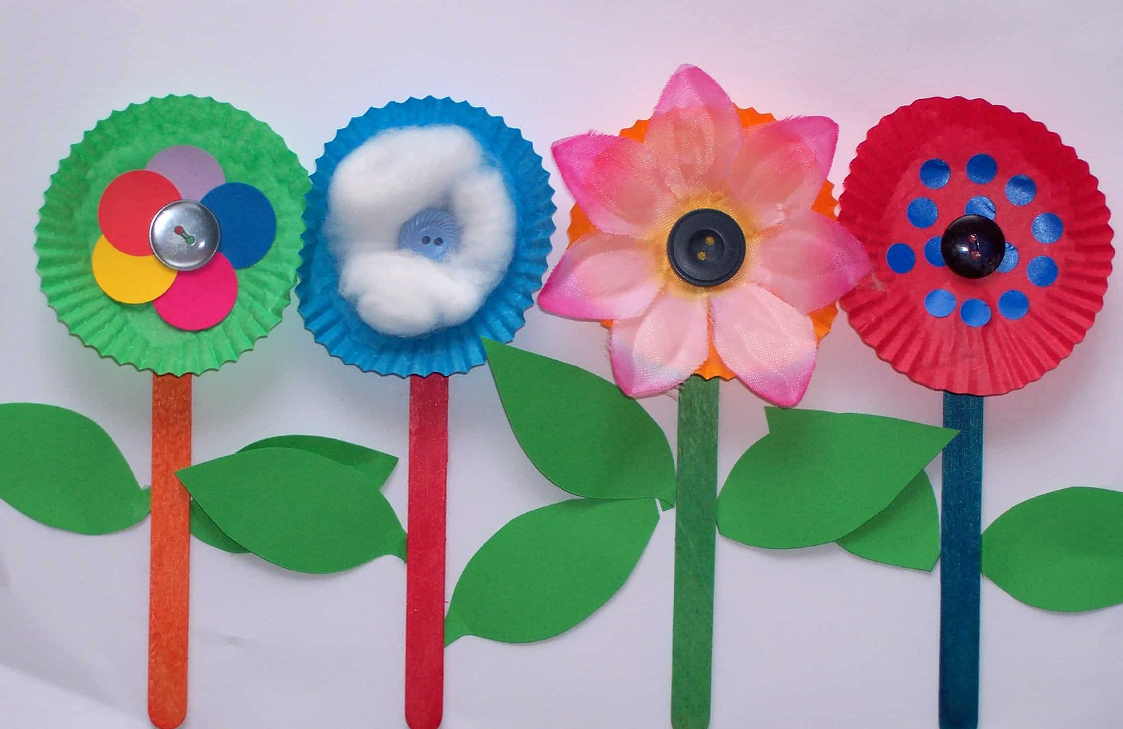 Cupcake liner, popsicle stick, and button flowers