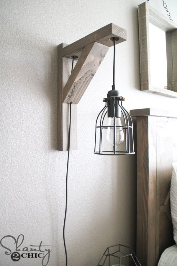 Diy rustic corbel light sconce