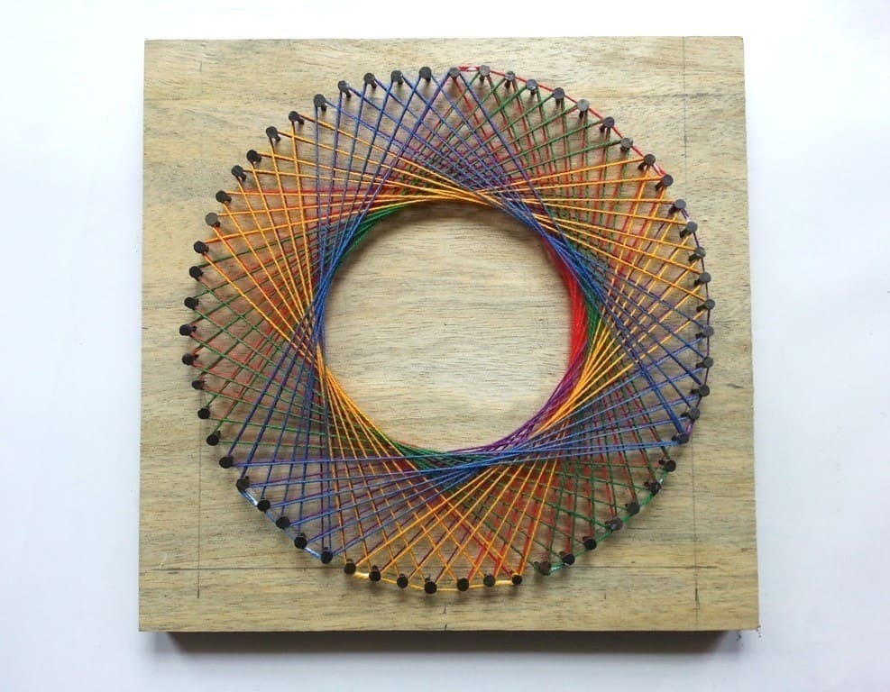 Diy rainbow spirograph string art