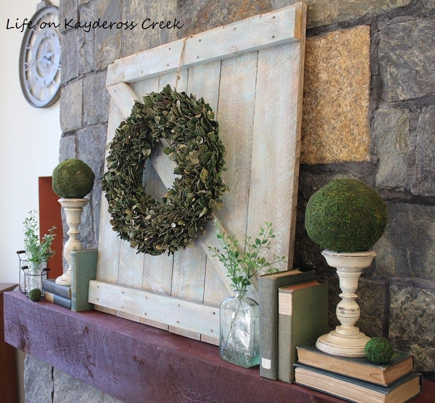 Decorative mantel barn door piece