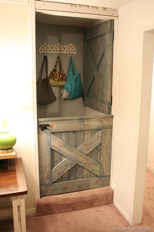 Dutch barn door style baby gate at the stairs