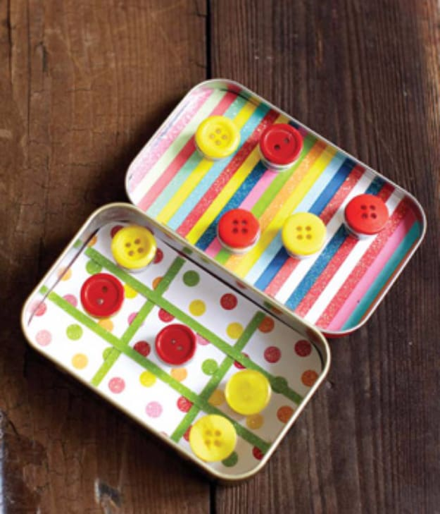Mini button and mint tin travel game